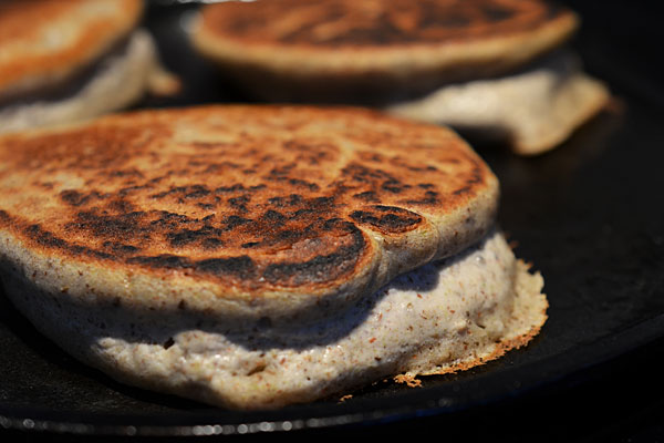 Buckwheat pancakes rising on griddle image
