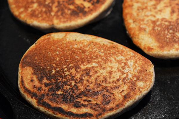 Buckwheat pancakes on griddle image